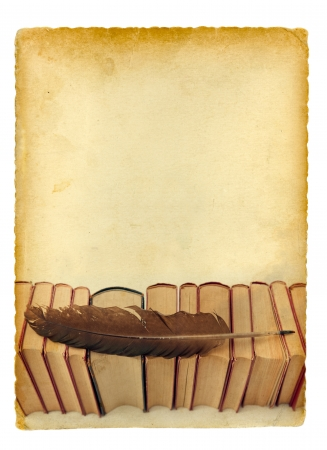 Books and quill on old paper background. Isolated on white. Stock Photo - 16188961