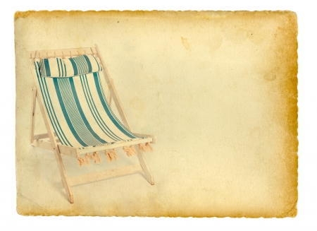 Strand stoel op oud papier achtergrond. Geà ¯ soleerd op wit. Stockfoto