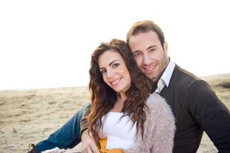 Beautiful smiling couple at the beach  photo