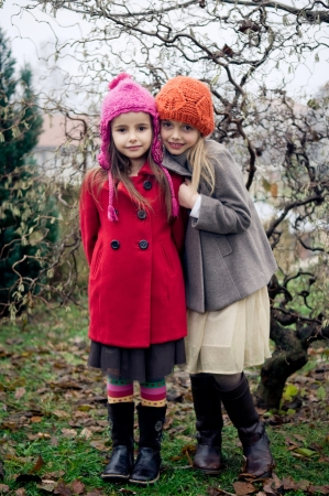 Two cute girls in vintage clothes posing photo
