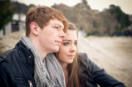 two stroke: Young teen couple embracing on the beach  Stock Photo
