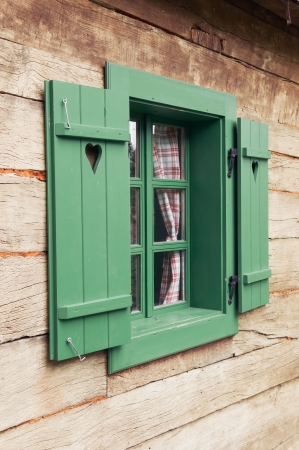 Wooden window on traditional log cabin photo