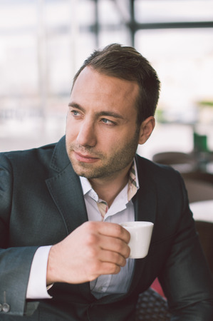 half dressed: Serious man drinking espresso in caffe  Stock Photo