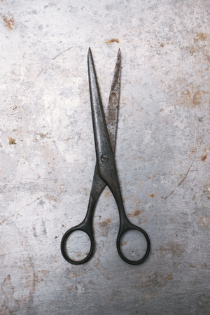 Vintage scissors on old metal background  photo