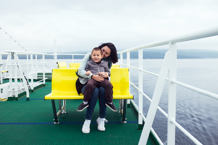 ferryboat: Mother and her son on a ferryboat