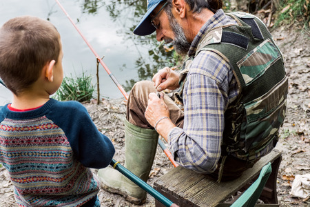 grandpapa: Man and his grandson fishing Stock Photo