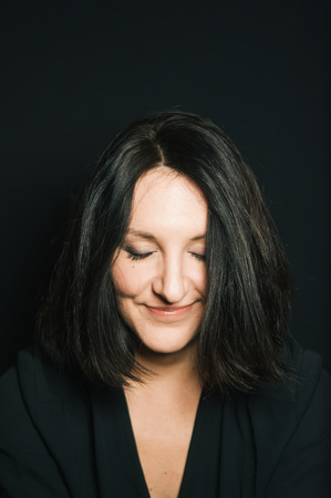 dark haired woman: Cute dark haired woman portrait on black background