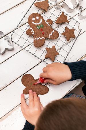 Little boy paiting gingerbread man photo