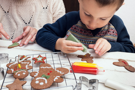 Little boy painting gingerbread man
