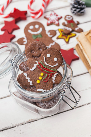 Gingerbread man in jar on white table photo
