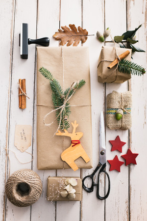 Homemade wrapped christmas presents with nature elements Stock Photo