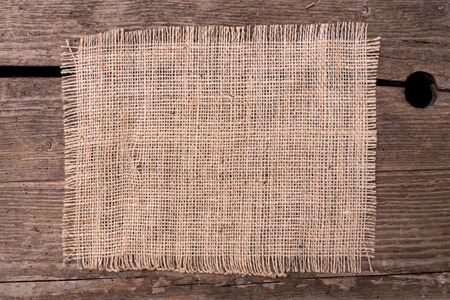 jute: Jute canvas background on wooden board
