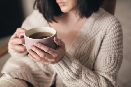 Detail of woman drinking tea