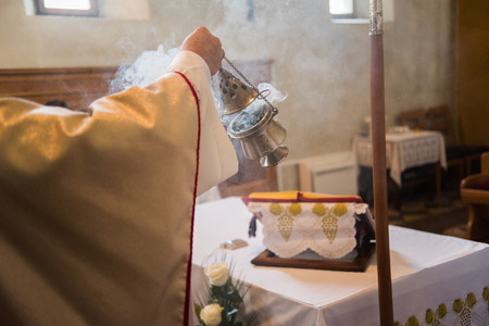 Incense during Mass at the altar photo