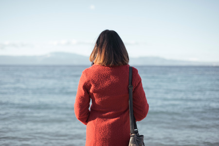 Lonely woman looking at the sea