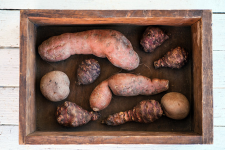 jerusalem artichoke: Sweet potato, jerusalem artichoke and potato in wooden box