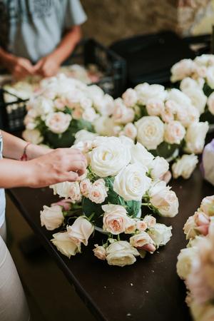 Florist arranging flowers for wedding