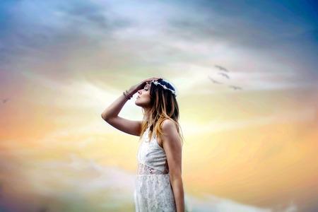 Young woman praying 스톡 콘텐츠