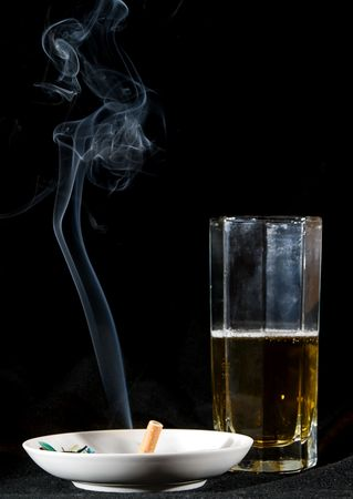 cigarette smoke and beer drink photo