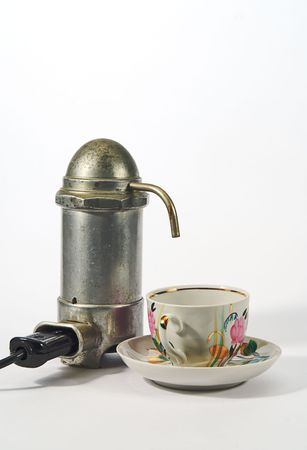 percolate: old aluminium electrical  coffee machine  and cup