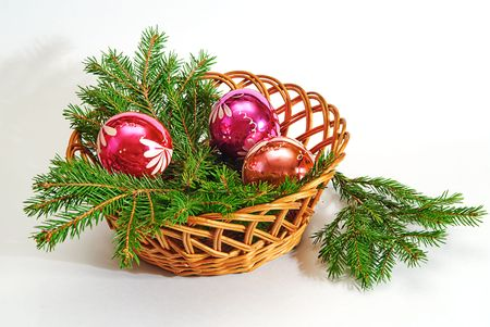 green  fir tree  twig and three red ball in basket photo