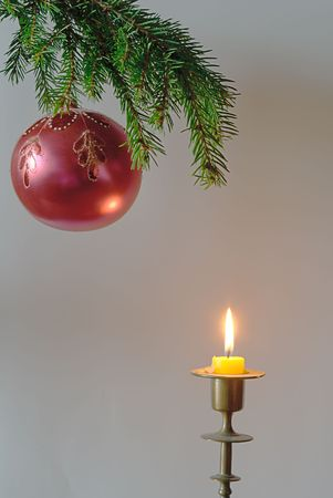 green  fir tree  twig and red ball and candle photo