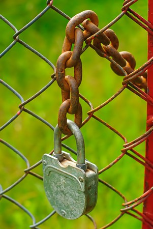 old padlock and rusty  chain in farm Stock Photo - 4453245