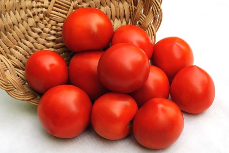 red tomato and hand made woode basket photo