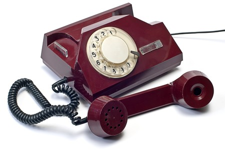 dialplate: old telephone on white isolated