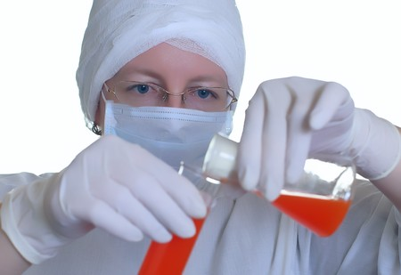 woman laboratory assistant whit chemical glasses photo