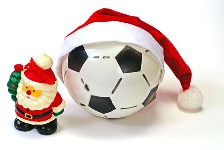 Santa Claus and the soccer ball on white isolated photo