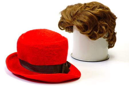 red wig and red  bonnet on white isolated Stock Photo - 6125875