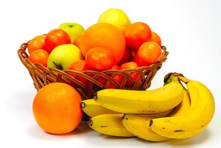 Basket with fruits, isolated on white background photo