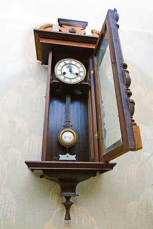 grandfather clock: Antique drum head grandfather clock  on a wall Stock Photo