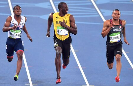 Rio De Janeiro, Brazil 15 August 2016: Jamaicas Usain Bolt smiles as he looks at Canadas Andre De Grasse, (R), during a semifinal mens 100 meters at the Olympic Summer Games in Rio de Janeiro