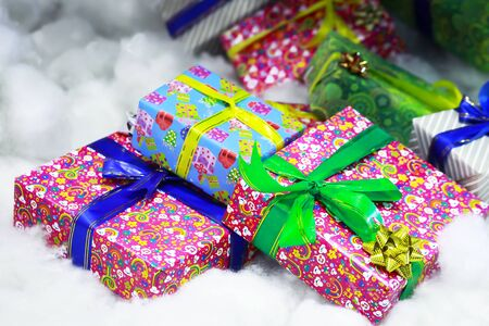 Present boxes in different colours conjunction with the Christmas Celebration Stock Photo