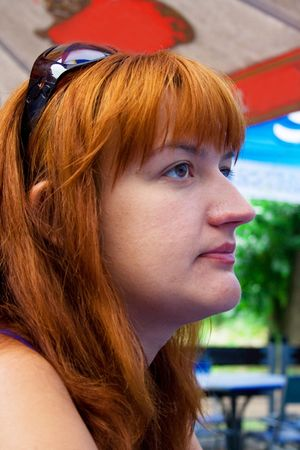 verandah: Portrait of the woman with red hair sitting on a summer verandah in cafe Stock Photo