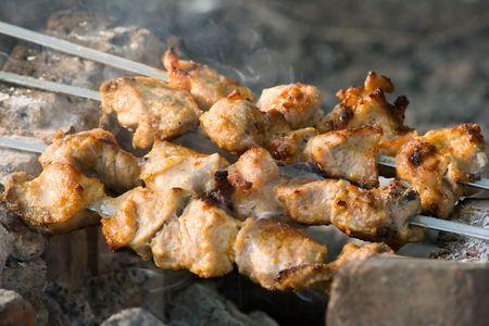 shish kebab: Preparing hot shish kebab on skewers