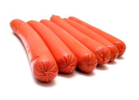 Some sausages on a white background. Isolation. Shalow DOF Stock Photo