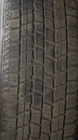 Old automobile tyre. A background photo