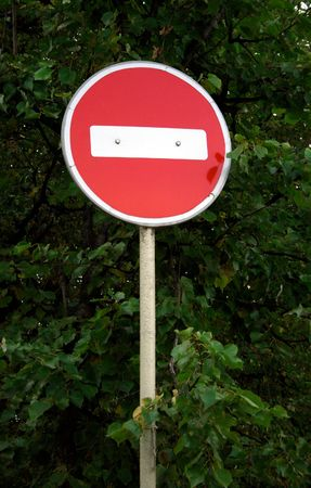 inhibit: Old Forbidden Traffic Sign against trees Stock Photo