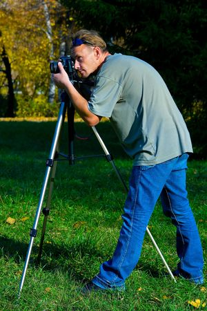 The photographer photographing the nature. Autumn, outdoor