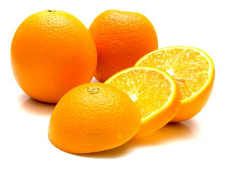 The ripe oranges on white, shallow DOF. Isolation. Stock Photo