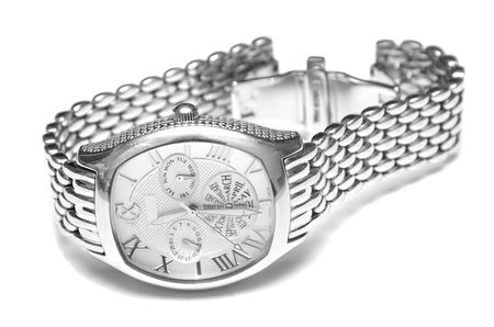 Silver man's watch. Isolation on a white background. Macro. Shallow DOF