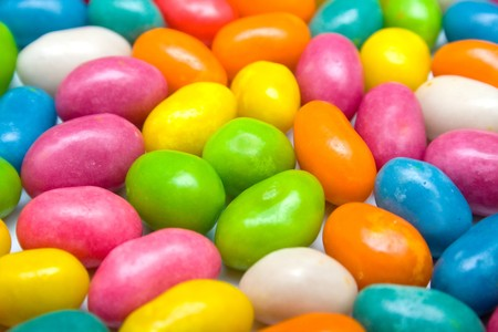 sugarcoated: Set of sweet dragees of different color. A background