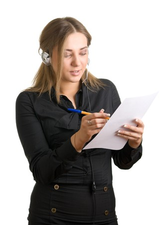 young woman in ear-phones writes something on a sheet of paper. Isolation on a white background Stock Photo - 4101402