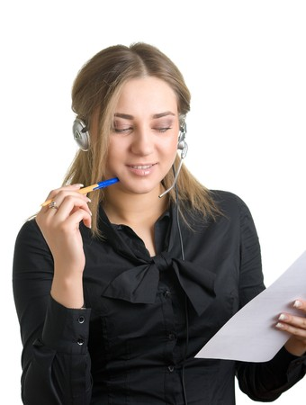 young woman in earphones writes something on a sheet of paper. Isolation on a white background Stock Photo - 4110517