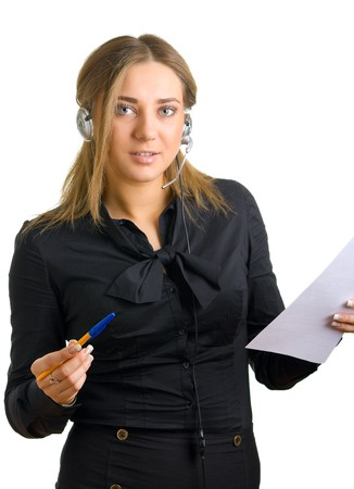 young woman in earphones writes something on a sheet of paper. Isolation on a white background Stock Photo - 4119091