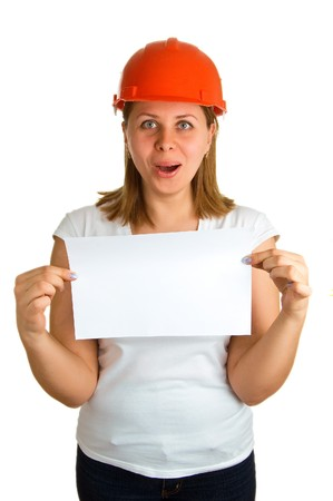 Surprised young women in a red building helmet with a sheet of paper in a hand. Isolation on a white background Stock Photo - 4504564