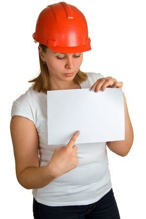 The young women in a red building helmet shows on a sheet of paper in a hand. Isolation on a white background Stock Photo - 4631514